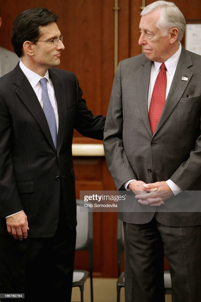 House Majority Leader <a gi-track='captionPersonalityLinkClicked' href=/galleries/search?phrase=Eric+Cantor&family=editorial&specificpeople=653711 ng-click='$event.stopPropagation()'>Eric Cantor</a> (R-VA) (L) and House Minority Whip <a gi-track='captionPersonalityLinkClicked' href=/galleries/search?phrase=Steny+Hoyer&family=editorial&specificpeople=588093 ng-click='$event.stopPropagation()'>Steny Hoyer</a> (D-MD) attend the dedication ceremony of the Gabriel Zimmerman Meeting Room in the U.S. Capitol Visitors Center April 16, 2013 in Washington, DC. A member of Giffords' Congressional staff, Gabriel Zimmerman was murdered during a shooting spree January 8, 2011 that left six dead and 13 injured, including Giffords.