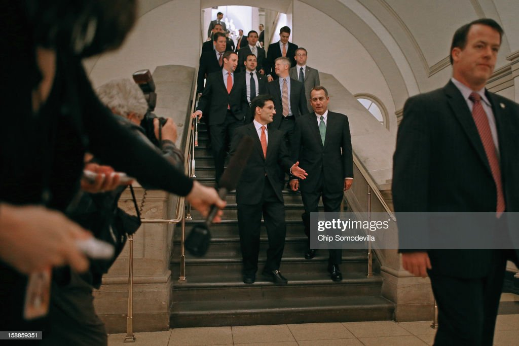 House Majority Leader <a gi-track='captionPersonalityLinkClicked' href=/galleries/search?phrase=Eric+Cantor&family=editorial&specificpeople=653711 ng-click='$event.stopPropagation()'>Eric Cantor</a> (R-VA) (L) and Speaker of the House <a gi-track='captionPersonalityLinkClicked' href=/galleries/search?phrase=John+Boehner&family=editorial&specificpeople=274752 ng-click='$event.stopPropagation()'>John Boehner</a> (R-OH) walk together to a meeting of the House Republican Caucus to discuss the Senate's legislation that is supposed to blunt the effects of the 'fiscal cliff' during a rare New Year's Day session January 1, 2013 in Washington, DC. Vice President Joe Biden and Senate Minority Leader Mitch McConnell (R-KY) negotiated the deal that produced The American Taxpayer Relief Act of 2012, which passed the Senate after midnight on New Year's Day.