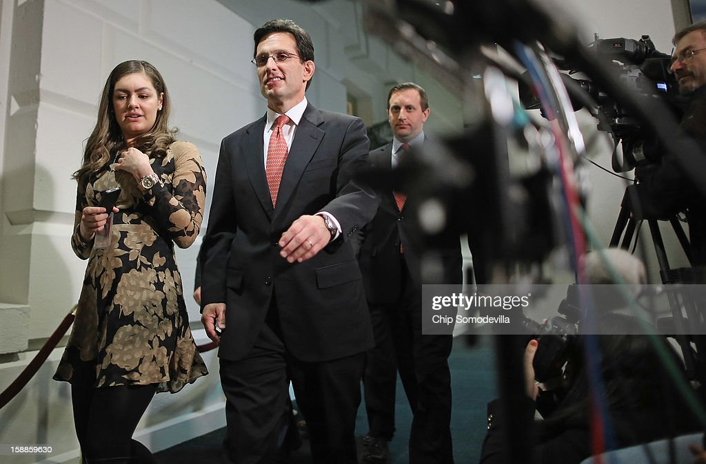 House Majority Leader <a gi-track='captionPersonalityLinkClicked' href=/galleries/search?phrase=Eric+Cantor&family=editorial&specificpeople=653711 ng-click='$event.stopPropagation()'>Eric Cantor</a> (R-VA) C) leaves the second House Republican Caucus meeting of the day during a rare New Year's Day session January 1, 2013 in Washington, DC. The House is considering a negotiated bill to avert the 'fiscal cliff' that passed the Senate in the early hours Tuesday.