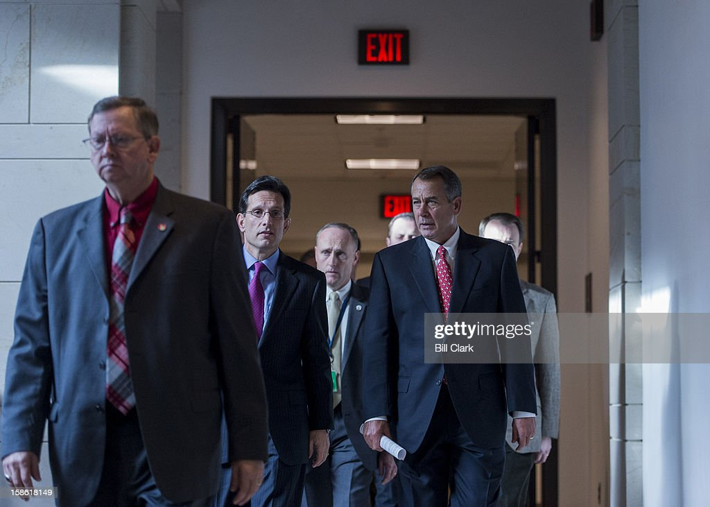 House Majority Leader Eric Cantor, R-Va., center left, and Speaker of the House John Boehner, R-Ohio, make their way to their news conference to speak about the fiscal cliff and the failed Plan B on Friday, Dec. 21, 2012.