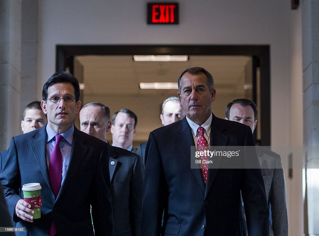 House Majority Leader Eric Cantor, R-Va., left, and Speaker of the House John Boehner, R-Ohio, make their way to their news conference to speak about the fiscal cliff and the failed Plan B on Friday, Dec. 21, 2012.