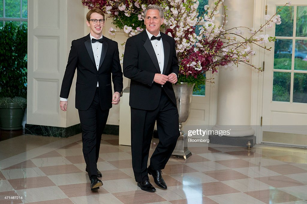 House Majority Leader Kevin McCarthy, a Republican from California, right, and son Connor McCarthy arrive at a state dinner hosted by U.S. President Barack Obama and U.S. First Lady Michelle Obama in honor of Japan's Prime Minister Shinzo Abe at the White House in Washington, D.C., U.S., on Tuesday, April 28, 2015. Prime Minister Shinzo Abe goes before the U.S. Congress on Wednesday to present Japan as a stalwart ally that's willing to play a bigger military role in Asia, a message likely to be embraced in Washington and greeted with suspicion in Seoul and Beijing. Photographer: Andrew Harrer/Bloomberg via Getty Images