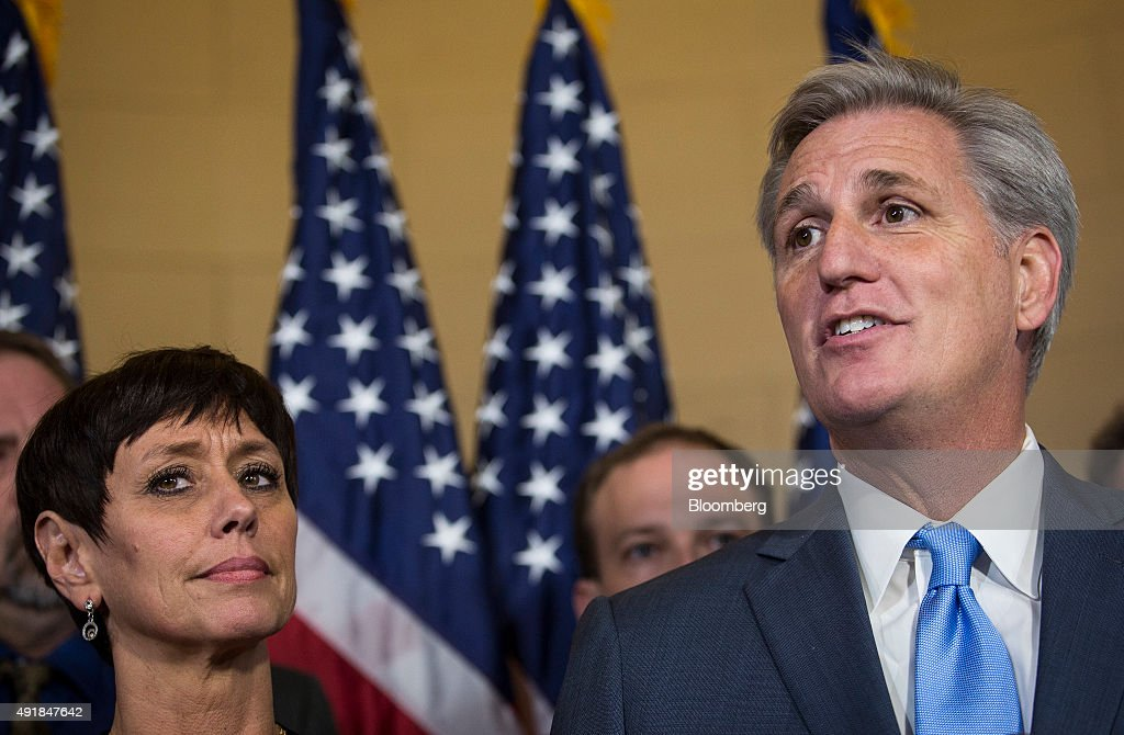 House Majority Leader Kevin McCarthy, a Republican from California, right, stands with his wife Judy McCarthy while speaking to the media on Capitol Hill in Washington, D.C., U.S., on Thursday, Oct. 8, 2015. McCarthy dropped out of the race for U.S. House speaker on the day his party was poised to nominate him to replace John Boehner, as an internal Republican feud erupted into open warfare on Capitol Hill. Photographer: Drew Angerer/Bloomberg via Getty Images