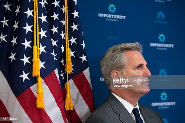 House Majority Leader Kevin McCarthy listens as Speaker of the House John Boehner speaks during a press conference after a closed meeting with fellow...