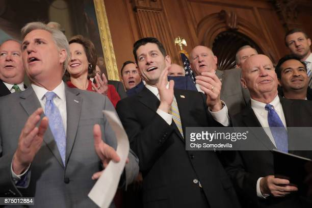 House Majority Leader Kevin McCarthy Speaker of the House Paul Ryan and House Ways and Means Committee Chairman Kevin Brady applaud with their fellow...