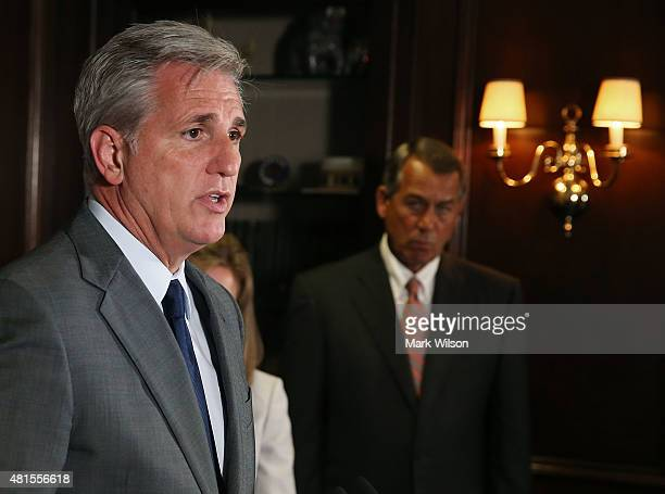 House Majority Leader Kevin McCarthy speaks while flanked by House Speaker John Boehner during a news conference at GOP headquarters on Capitol Hill...
