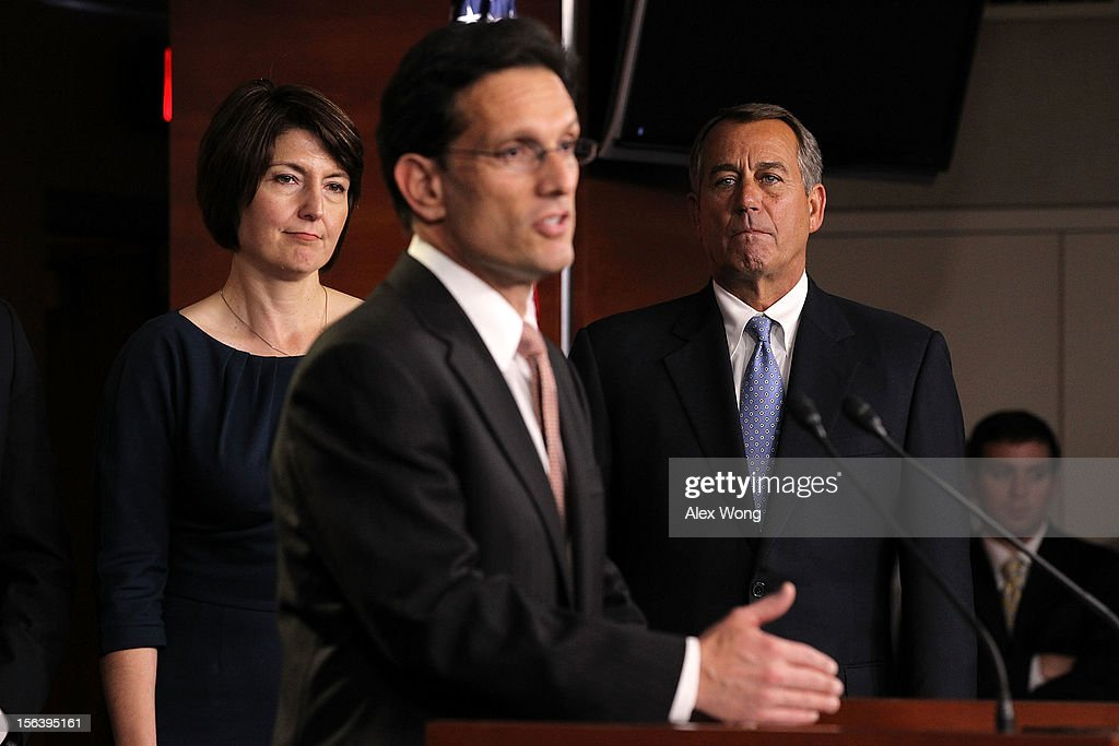 U.S. House Majority Leader Rep. <a gi-track='captionPersonalityLinkClicked' href=/galleries/search?phrase=Eric+Cantor&family=editorial&specificpeople=653711 ng-click='$event.stopPropagation()'>Eric Cantor</a> (R-VA) (C) speaks as Speaker of the House Rep. <a gi-track='captionPersonalityLinkClicked' href=/galleries/search?phrase=John+Boehner&family=editorial&specificpeople=274752 ng-click='$event.stopPropagation()'>John Boehner</a> (R-OH) (R) and Rep. Cathy McMorris Rodgers (R-WA) (L) listen during a news conference to introduce the House Republican leadership for the next Congress November 14, 2012 on Capitol Hill in Washington, DC. The House Republicans have picked their choices of leadership for the 113th Congress.