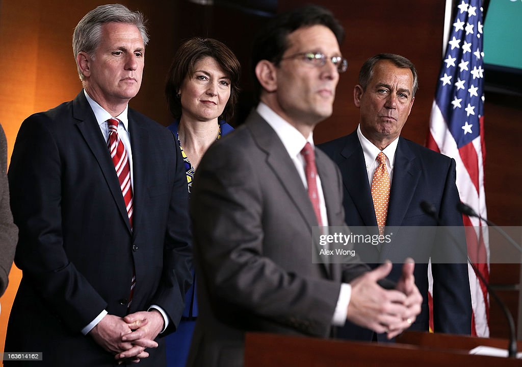 U.S. House Majority Leader Rep. <a gi-track='captionPersonalityLinkClicked' href=/galleries/search?phrase=Eric+Cantor&family=editorial&specificpeople=653711 ng-click='$event.stopPropagation()'>Eric Cantor</a> (R-VA) (3rd L) speaks as Speaker of the House Rep. <a gi-track='captionPersonalityLinkClicked' href=/galleries/search?phrase=John+Boehner&family=editorial&specificpeople=274752 ng-click='$event.stopPropagation()'>John Boehner</a> (R-OH) (R), House Majority Whip Rep. Kevin McCarthy (R-CA) (L) and Rep. Cathy McMorris Rodgers (R-WA) (2nd L) look on during a news conference after a meeting between President Barack Obama and the House Republican Conference at the U.S. Capitol March 13, 2013 on Capitol Hill in Washington, DC. President Obama traveled to the Hill to meet with Republican House members in a closed meeting.