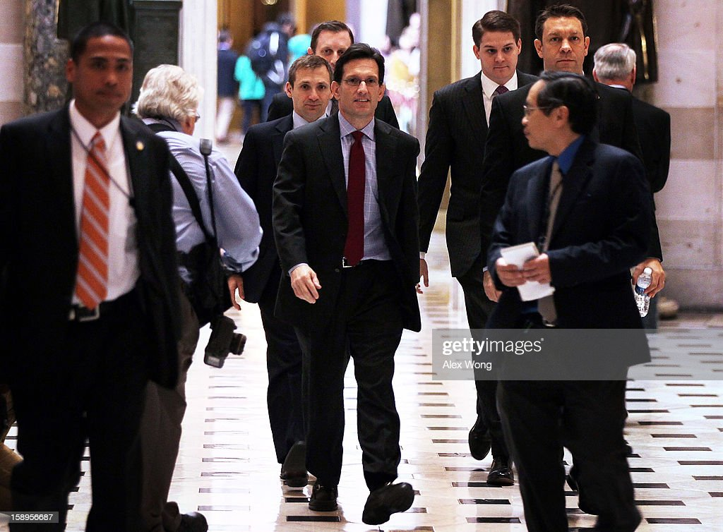 U.S. House Majority Leader Rep. <a gi-track='captionPersonalityLinkClicked' href=/galleries/search?phrase=Eric+Cantor&family=editorial&specificpeople=653711 ng-click='$event.stopPropagation()'>Eric Cantor</a> (R-VA) (C) walks in the Statuary Hall of the U.S. Capitol January 4, 2013 on Capitol Hill in Washington, DC. The House has passed a $9.7 billion Superstorm Sandy aid package for flood insurance claims.