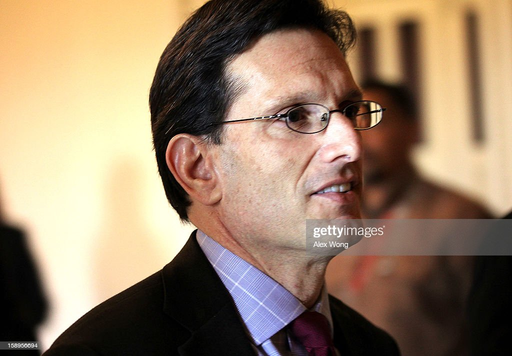 U.S. House Majority Leader Rep. <a gi-track='captionPersonalityLinkClicked' href=/galleries/search?phrase=Eric+Cantor&family=editorial&specificpeople=653711 ng-click='$event.stopPropagation()'>Eric Cantor</a> (R-VA) (C) walks towards the House Chamber at the U.S. Capitol January 4, 2013 on Capitol Hill in Washington, DC. The House has passed a $9.7 billion Superstorm Sandy aid package for flood insurance claims.
