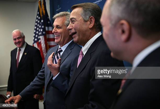 House Majority Leader Rep Kevin McCarthy and Speaker of the House Rep John Boehner share a moment as Rep Pta Meehan looks on during a media briefing...