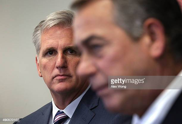 House Majority Leader Rep Kevin McCarthy listens as Speaker of the House Rep John Boehner speaks to member of the media after a House Republican...