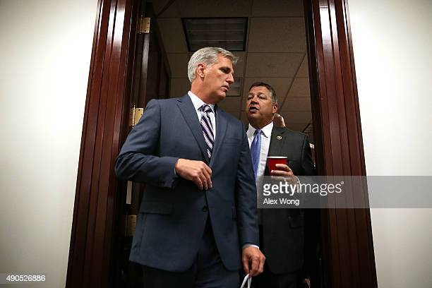 House Majority Leader Rep Kevin McCarthy talks to Rep Bill Shuster as they come out after a House Republican Conference meeting September 29 2015 at...