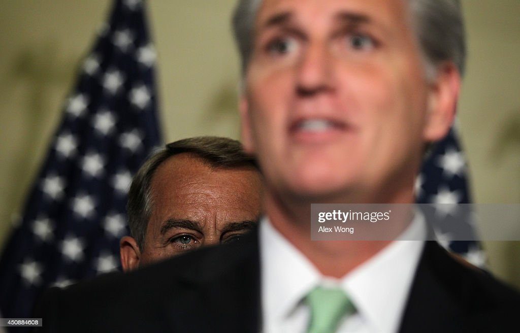 U.S. House Majority Whip Rep. <a gi-track='captionPersonalityLinkClicked' href=/galleries/search?phrase=Kevin+McCarthy+-+U.S.+Congressman&family=editorial&specificpeople=6726000 ng-click='$event.stopPropagation()'>Kevin McCarthy</a> (R-CA) (R) speaks to members of the media as Speaker of the House Rep. <a gi-track='captionPersonalityLinkClicked' href=/galleries/search?phrase=John+Boehner&family=editorial&specificpeople=274752 ng-click='$event.stopPropagation()'>John Boehner</a> (R-OH) (L) listens after a leadership election at a House Republican Conference meeting June 19, 2014 on Capitol Hill in Washington, DC. House GOPs have picked McCarthy as the new House majority leader and Rep. Steve Scalise (R-LA) as the new majority whip.
