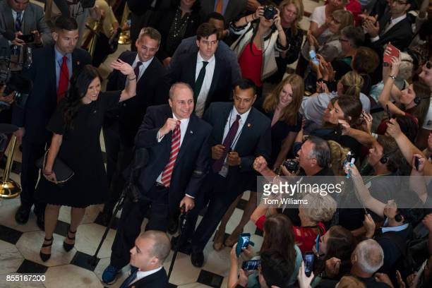 House Majority Whip Steve Scalise RLa and his wife Jennifer left walk through the Capitol's Statuary Hall on September 28 his first day back to the...