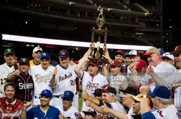 House Majority Whip Steve Scalise RLa helps hold up the trophy following the Republicans' win in the 2016 Congressional Baseball Game at Nationals...