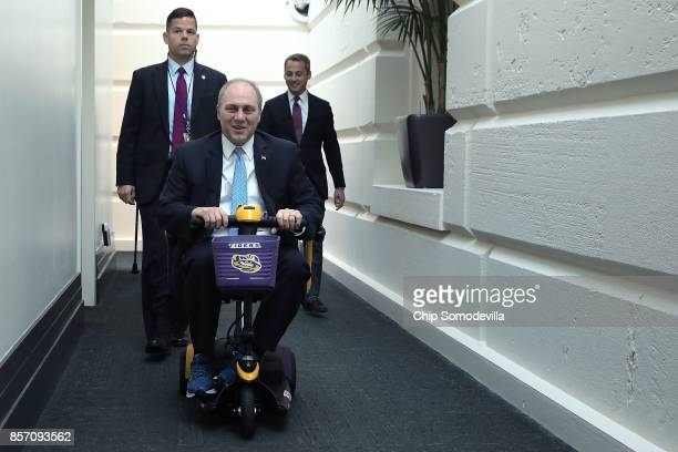 House Majority Whip Steve Scalise rides on a Louisiana State Universitythemed scooter as he arrives for the weekly House GOP conference meeting at...