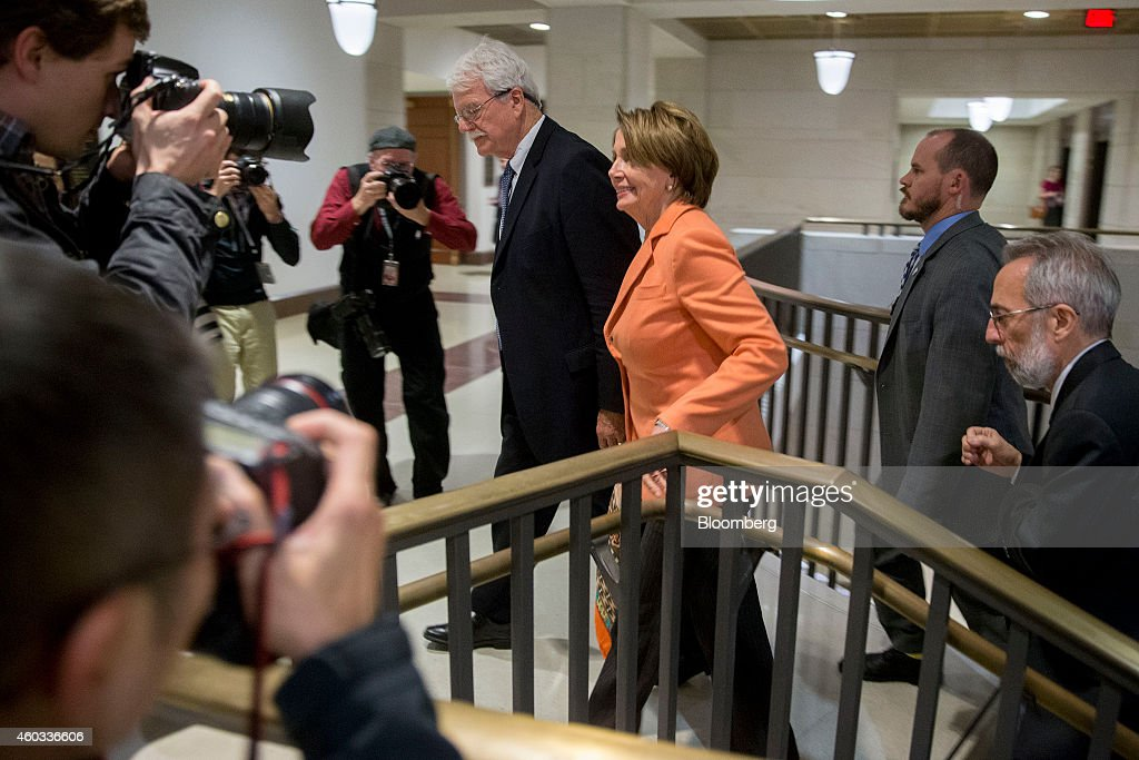 House Minority Leader Nancy Pelosi a Democrat from California center right walks with Representative George Miller a Democrat from California center...