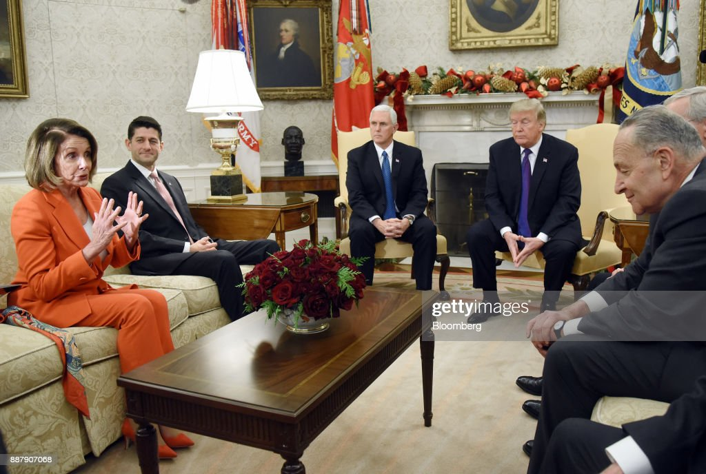 House Minority Leader Nancy Pelosi, a Democrat from California, from left, speaks as U.S. House Speaker Paul Ryan, a Republican from Wisconsin, U.S. Vice President Mike Pence, U.S. President Donald Trump, and Senate Minority Leader Chuck Schumer, a Democrat from New York, listen during a meeting in the Oval Office of the White House in Washington, D.C., U.S., on Thursday, Dec. 7, 2017. Trump is meeting with the congressional leaders from both parties to negotiate on a long-term budget deal as Congress prepares to pass a stopgap spending measure to avoid a U.S. government shutdown Saturday. Photographer: Olivier Douliery/Pool via Bloomberg