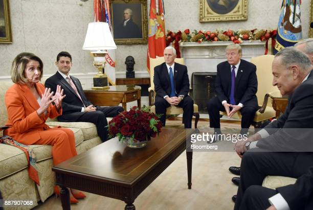 House Minority Leader Nancy Pelosi a Democrat from California from left speaks as US House Speaker Paul Ryan a Republican from Wisconsin US Vice...