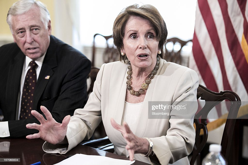 House Minority Leader <a gi-track='captionPersonalityLinkClicked' href=/galleries/search?phrase=Nancy+Pelosi&family=editorial&specificpeople=169883 ng-click='$event.stopPropagation()'>Nancy Pelosi</a>, a Democrat from California, right, and Representative <a gi-track='captionPersonalityLinkClicked' href=/galleries/search?phrase=Steny+Hoyer&family=editorial&specificpeople=588093 ng-click='$event.stopPropagation()'>Steny Hoyer</a>, a Democrat from Maryland, speak to the media after a meeting at the U.S. Capitol in Washington, D.C., U.S., on Wednesday, nov. 28, 2012. Business executives pressing for a solution to the so-called fiscal cliff made their case at the White House and the Capitol a day after Senate Majority Leader Harry Reid lamented the lack of progress toward a deal. Photographer: T.J. Kirkpatrick/Bloomberg via Getty Images