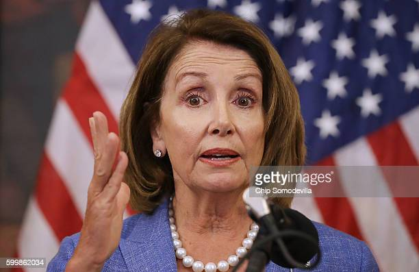 House Minority Leader Nancy Pelosi and fellow Democratic members of the House hold a news conference to call on Republicans to fund programs to...