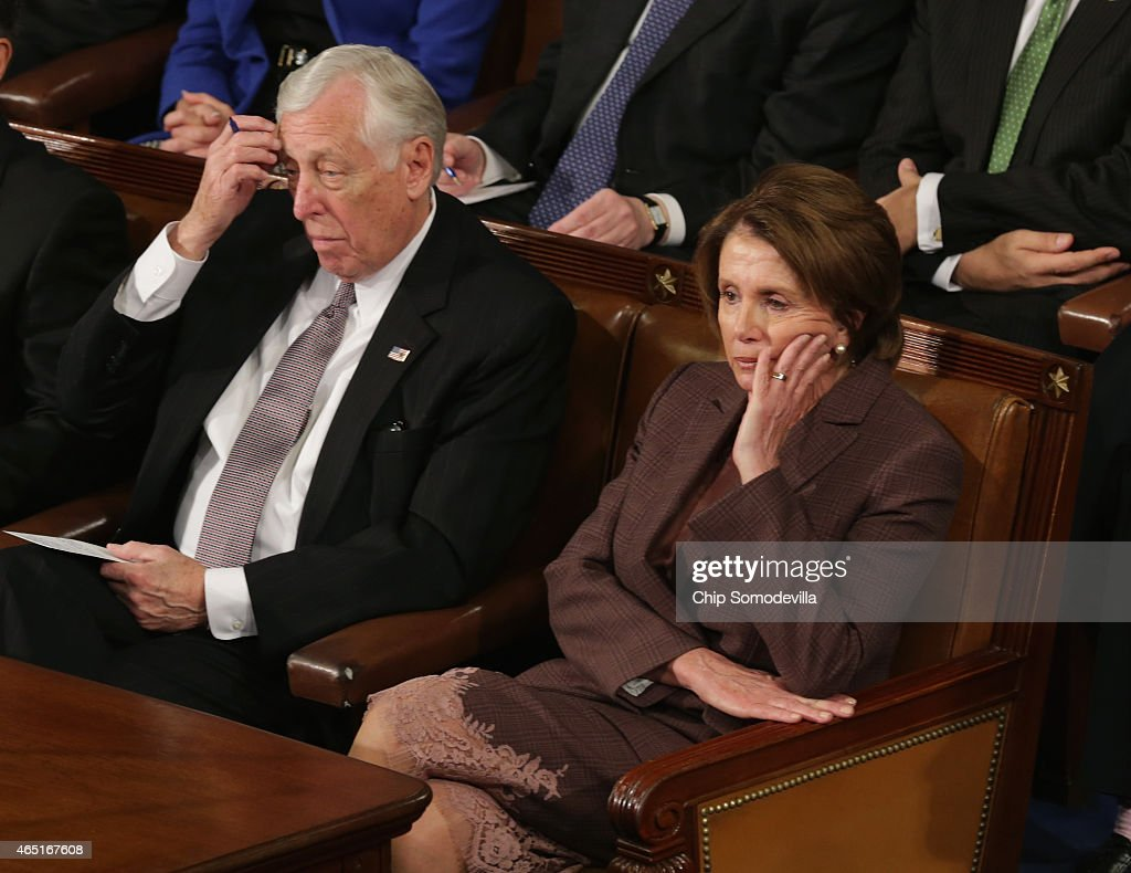 House Minority Leader <a gi-track='captionPersonalityLinkClicked' href=/galleries/search?phrase=Nancy+Pelosi&family=editorial&specificpeople=169883 ng-click='$event.stopPropagation()'>Nancy Pelosi</a> (D-CA) (R) and House Minority Whip <a gi-track='captionPersonalityLinkClicked' href=/galleries/search?phrase=Steny+Hoyer&family=editorial&specificpeople=588093 ng-click='$event.stopPropagation()'>Steny Hoyer</a> (D-MD)(L) listen to Israeli Prime Minister Benjamin Netanyahu speak about Iran during a joint meeting of the United States Congress in the House chamber at the U.S. Capitol March 3, 2015 in Washington, DC. At the risk of further straining the relationship between Israel and the Obama Administration, Netanyahu warned members of Congress against what he considers an ill-advised nuclear deal with Iran.