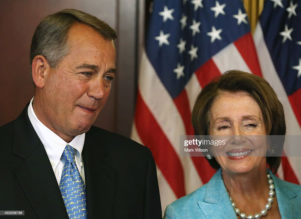 House Minority Leader <a gi-track='captionPersonalityLinkClicked' href=/galleries/search?phrase=Nancy+Pelosi&family=editorial&specificpeople=169883 ng-click='$event.stopPropagation()'>Nancy Pelosi</a> (D-CA) (R) and House Speaker <a gi-track='captionPersonalityLinkClicked' href=/galleries/search?phrase=John+Boehner&family=editorial&specificpeople=274752 ng-click='$event.stopPropagation()'>John Boehner</a> (R-OH) await to sign bipartisan legislation Workforce Innovation and Opportunity Act. at the U.S. Capitol, July 11, 2014 in Washington, DC. Also pictured are Ranking Member of the House Education & Workforce Committee George Miller (D-CA) (2ndL), Chairman of the House Education & Workforce Committee John Kline (R-MN) (3rdL), Rep. Virginia Foxx (R-NC)(2nd-R) and Rep. Ruben Hinojosa (D-TX) (R).