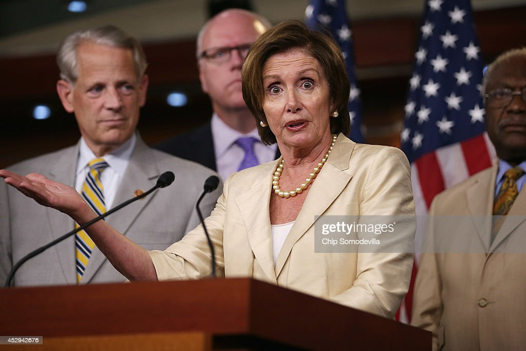 House Minority Leader <a gi-track='captionPersonalityLinkClicked' href=/galleries/search?phrase=Nancy+Pelosi&family=editorial&specificpeople=169883 ng-click='$event.stopPropagation()'>Nancy Pelosi</a> (D-CA) and members of the House Democratic leadership hold a news conference after the House voted 225-201 to authorize a lawsuit against the President Barack Obama at the U.S. Capitol July 30, 2014 in Washington, DC. The House passed the Republican legislation authorizing the lawsuit that claims Obama overstepped his powers in ordering changes to his signature health care law, the Affordable Care Act.