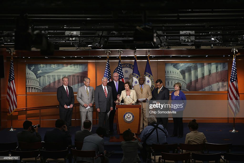 House Minority Leader Nancy Pelosi (D-CA) (C) and members of the House Democratic leadership hold a news conference after the House voted to authorize a lawsuit against the President Barack Obama at the U.S. Capitol July 30, 2014 in Washington, DC. The House voted on the Republican legislation authorizing the lawsuit that claims Obama overstepped his powers in ordering changes to his signature health care law, the Affordable Care Act.