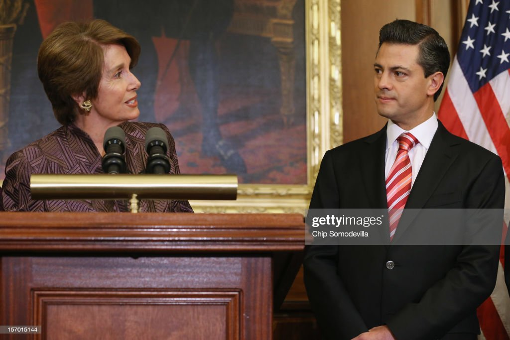 House Minority Leader Nancy Pelosi (D-CA) (L) and Mexican President-Elect Enrique Pena Nieto make brief remarks during a photo opportunity in the Rayburn Room at the U.S. Capitol November 27, 2012 in Washington, DC. Nieto, of Mexico's Institutional Revolutionary Party, will also visit the White House and meet with President Barack Obama today, days before he takes office on December 1.