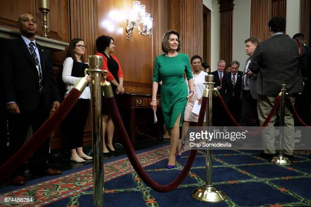 House Minority Leader Nancy Pelosi and Rep Barbara Lee arrive for a news conference in the Rayburn Room at the US Capitol April 28 2017 in Washington...