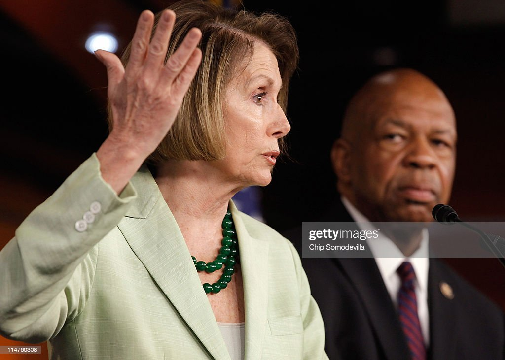 House Minority Leader <a gi-track='captionPersonalityLinkClicked' href=/galleries/search?phrase=Nancy+Pelosi&family=editorial&specificpeople=169883 ng-click='$event.stopPropagation()'>Nancy Pelosi</a> (D-CA) (L) and Rep. <a gi-track='captionPersonalityLinkClicked' href=/galleries/search?phrase=Elijah+Cummings&family=editorial&specificpeople=725911 ng-click='$event.stopPropagation()'>Elijah Cummings</a> (D-MA) hold a news conference at the U.S. Capitol May 26, 2011 in Washington, DC. During her weekly press conference, Pelosi accused Republicans of wanting to cut taxes for oil companies at the expense of Medicare recipients.