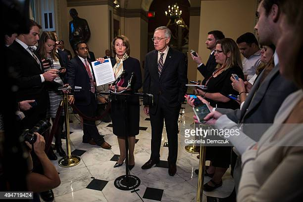 House Minority Leader Nancy Pelosi and Senate Minority Leader Harry Reid speak to reporters on the bipartisan budget agreement at a press event at...