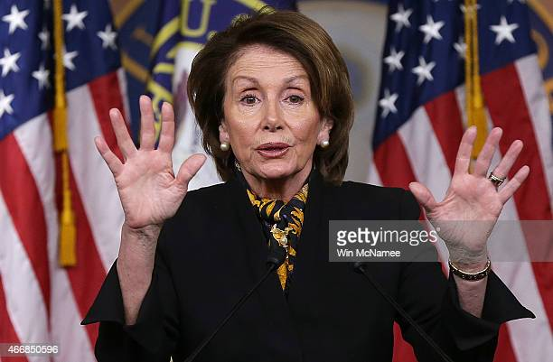 House Minority Leader Nancy Pelosi answers questions during her weekly press conference at the US Capitol on March 19 2015 in Washington DC Pelosi...