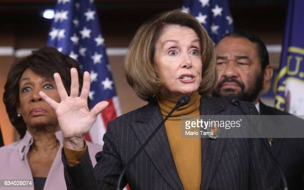 House Minority Leader Nancy Pelosi C speaks as US Rep Maxine Waters L and Rep Al Green stand at a news conference criticizing President Donald...