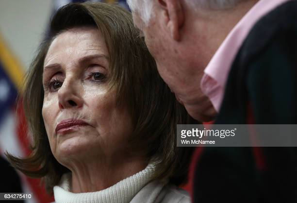 House Minority Leader Nancy Pelosi confers with Rep Steny Hoyer while attending an opening news conference during the House Democratic caucus 'Issues...