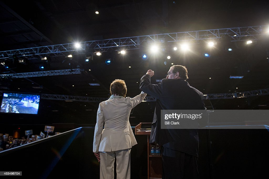 House Minority Leader Nancy Pelosi, D-Calif., and United Steelworkers president Leo Gerard hold their hands up in the air after Pelosi's speech to the United Steelworkers Convention in Las Vegas, Nev., on Monday, Aug. 11, 2014.