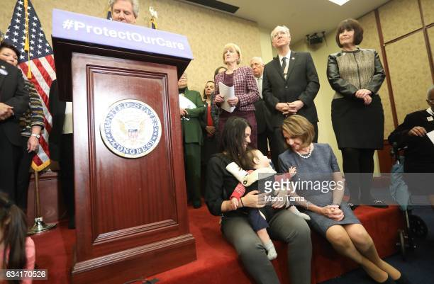 House Minority Leader Nancy Pelosi greets Ilene Stein and her son Emmett Lyzenga 9 months at a news conference with advocates of the Affordable Care...