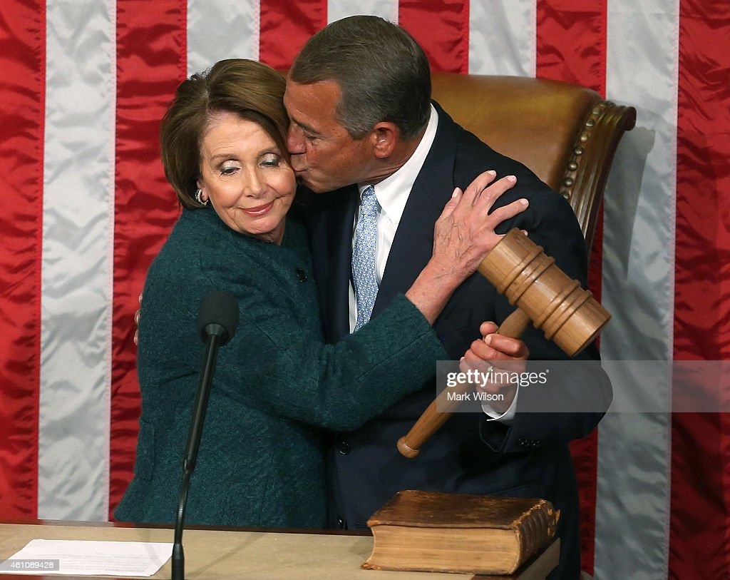 House Minority Leader <a gi-track='captionPersonalityLinkClicked' href=/galleries/search?phrase=Nancy+Pelosi&family=editorial&specificpeople=169883 ng-click='$event.stopPropagation()'>Nancy Pelosi</a> (D-CA) (L) hands Speaker of the House <a gi-track='captionPersonalityLinkClicked' href=/galleries/search?phrase=John+Boehner&family=editorial&specificpeople=274752 ng-click='$event.stopPropagation()'>John Boehner</a> (R-OH) the speaker's gavel during the first session of the 114th Congress in the House Chambers January 6, 2015 in Washington, DC. Today Congress convened its first session of the 114th Congress with Republicans controlling both the House and Senate.