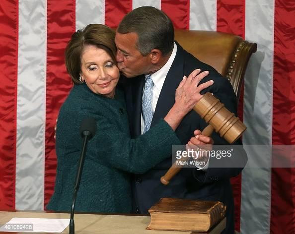 House Minority Leader Nancy Pelosi hands Speaker of the House John Boehner the speaker's gavel during the first session of the 114th Congress in the...