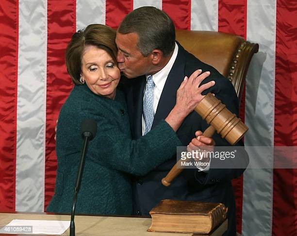 House Minority Leader Nancy Pelosi hands Speaker of the House John Boehner the speaker's gavel during the first session of the 114th Congress in the...