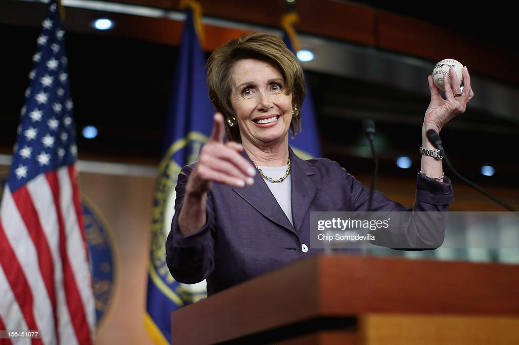House Minority Leader <a gi-track='captionPersonalityLinkClicked' href=/galleries/search?phrase=Nancy+Pelosi&family=editorial&specificpeople=169883 ng-click='$event.stopPropagation()'>Nancy Pelosi</a> (D-CA) holds up a World Series baseball autographed by San Francisco Giants players from the past and present during her weekly news conference at the U.S. Capitol November 15, 2012 in Washington, DC. Pelosi took questions from reporters about the 'fiscal cliff,' the debt ceiling, working with Republicans and other matters the Congress must face in the lame duck session.