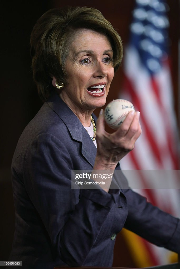 House Minority Leader Nancy Pelosi (D-CA) holds up a World Series baseball autographed by San Francisco Giants players from the past and present during her weekly news conference at the U.S. Capitol November 15, 2012 in Washington, DC. Pelosi took questions from reporters about the 'fiscal cliff,' the debt ceiling, working with Republicans and other matters the Congress must face in the lame duck session.