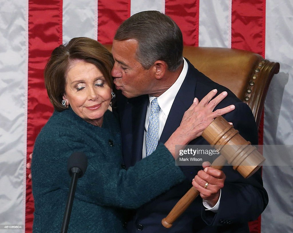 House Minority Leader <a gi-track='captionPersonalityLinkClicked' href=/galleries/search?phrase=Nancy+Pelosi&family=editorial&specificpeople=169883 ng-click='$event.stopPropagation()'>Nancy Pelosi</a> (D-CA) (L) is kissed by Speaker of the House <a gi-track='captionPersonalityLinkClicked' href=/galleries/search?phrase=John+Boehner&family=editorial&specificpeople=274752 ng-click='$event.stopPropagation()'>John Boehner</a> (R-OH) as he is handed the speaker's gavel during the first session of the 114th Congress in the House Chambers January 6, 2015 in Washington, DC. Today Congress convened its first session of the 114th Congress with Republicans controlling both the House and Senate.
