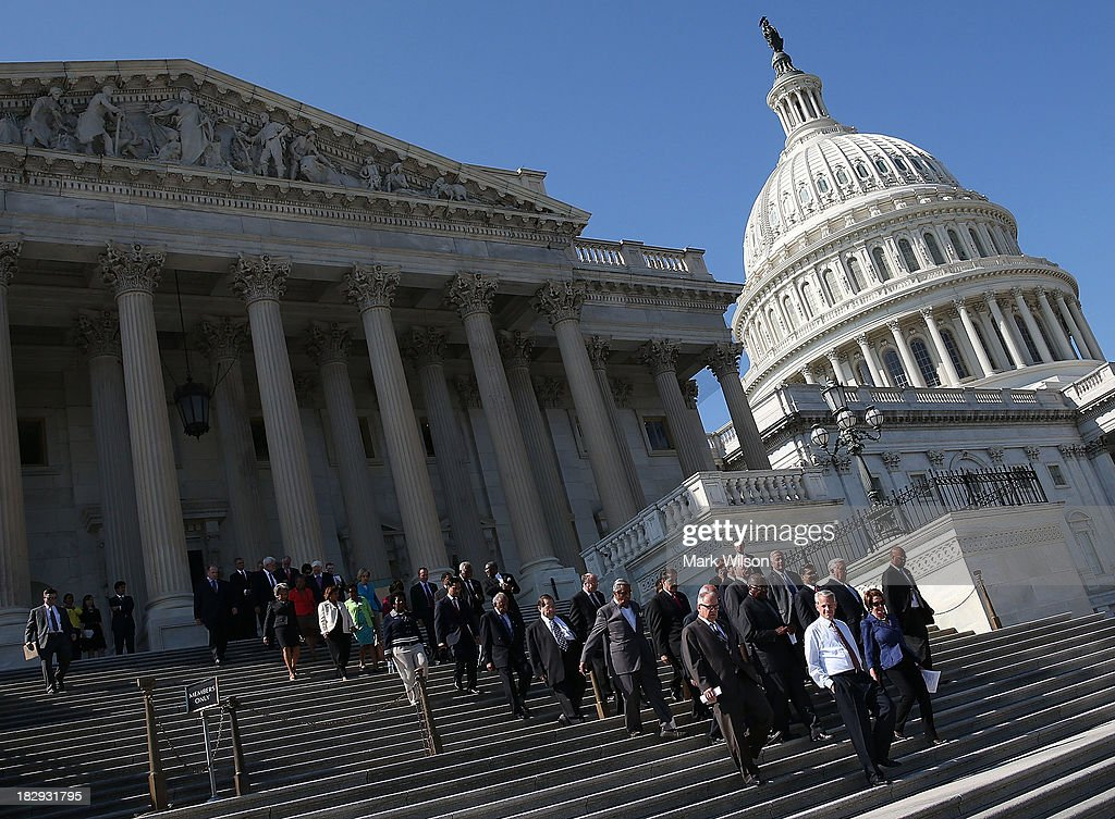 House Minority Leader <a gi-track='captionPersonalityLinkClicked' href=/galleries/search?phrase=Nancy+Pelosi&family=editorial&specificpeople=169883 ng-click='$event.stopPropagation()'>Nancy Pelosi</a> joined by House Democrats walks down the steps of the House for a news conference on the federal government shutdown at the U.S. Capitol on October 2, 2013 in Washington, DC. Later today President Barack Obama will meet with congressional leaders at the White House to discuss an end to the government shutdown.