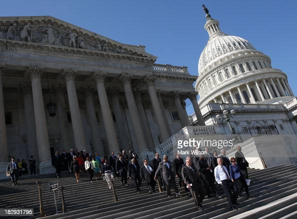 House Minority Leader Nancy Pelosi joined by House Democrats walks down the steps of the House for a news conference on the federal government...