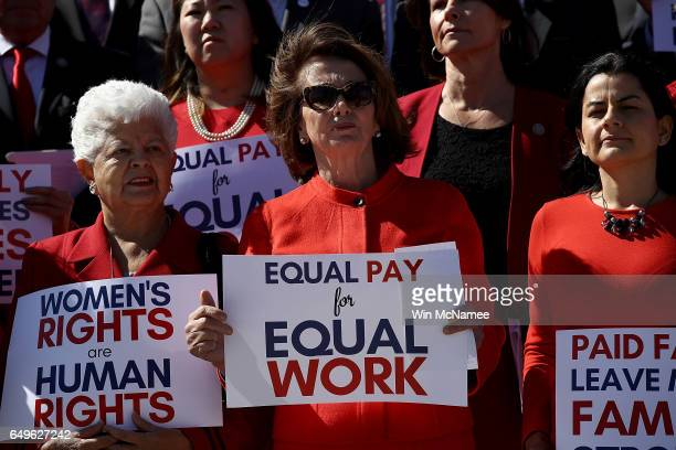 House Minority Leader Nancy Pelosi joins with women members of the House Democratic caucus at a press conference marking International WomenÕs Day...