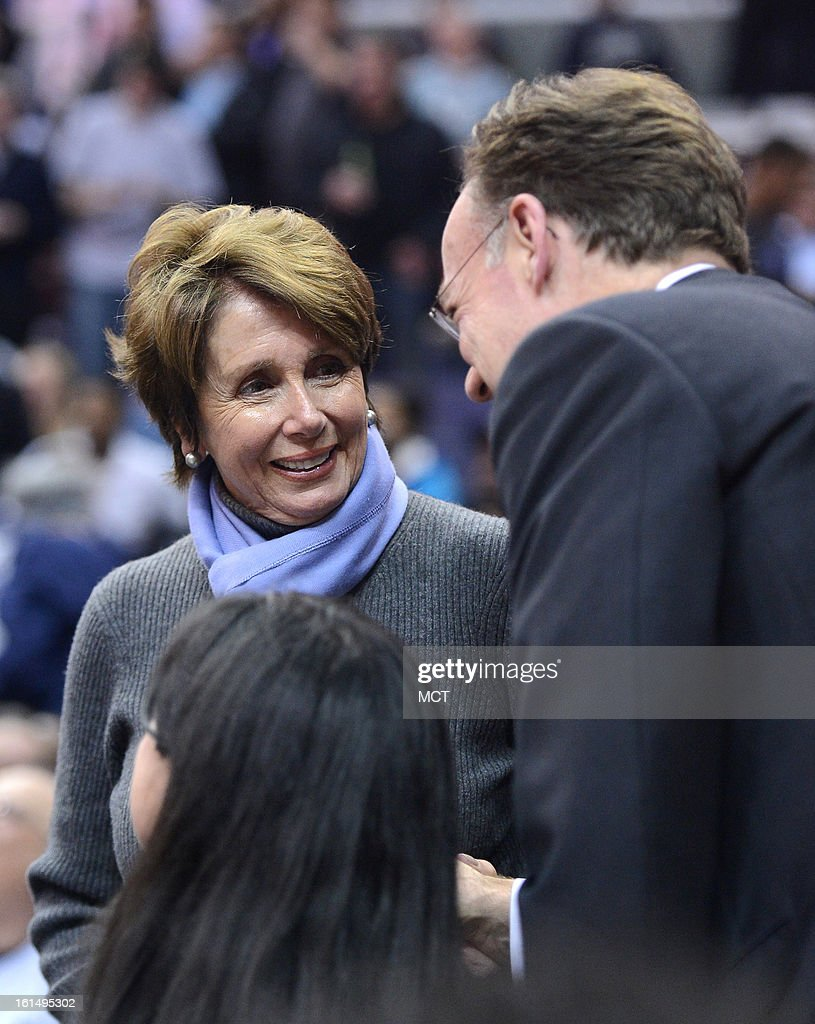 U.S. House Minority Leader Nancy Pelosi (D-CA), left, speaks with Georgetown University President John J. DeGioia on the sideline during the second half between Georgetown and Marquette at the Verizon Center in Washington, D.C., Monday, February 11, 2013. Georgetown defeated Marquette, 63-55.