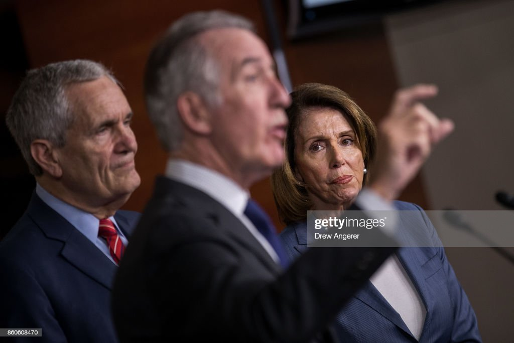 House Minority Leader Nancy Pelosi (at R) (D-CA) looks on as ranking member of the House Ways and Means Committee Rep. Richard Neal (C) (D-MA) speaks during a news conference on Republican plans to end the state and local tax deduction, on Capitol Hill, October 12, 2017 in Washington, DC. Also pictured is Rep. Lloyd Doggett (L) (D-TX). The Democrats called on Congressional Republicans to hold open and public hearings on their plans for tax reform.